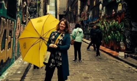 Fiona in Hosier Lane with Hidden Secrets Tours yellow umbrella